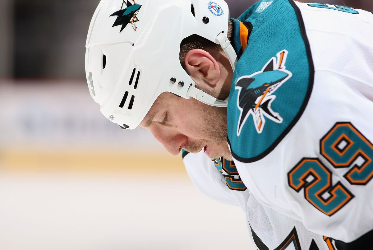 GLENDALE, AZ - MARCH 10: Ryane Clowe #29 of the San Jose Sharks looks down as he awaits a face off against the Phoenix Coyotes during the NHL game at Jobing.com Arena on March 10, 2012 in Glendale, Arizona. The Coyotes defeated the Sharks 3-0.