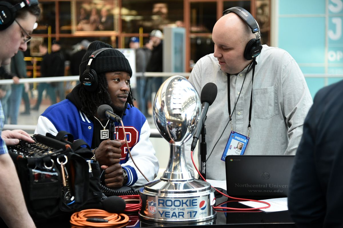 BLOOMINGTON, MN:  NFL running back Alvin Kamara of the New  Orleans Saints, winner of the 2017 Pepsi NFL Rookie of the Year trophy,  interviews at Radio Row inside the Mall of America before Super Bowl 51.