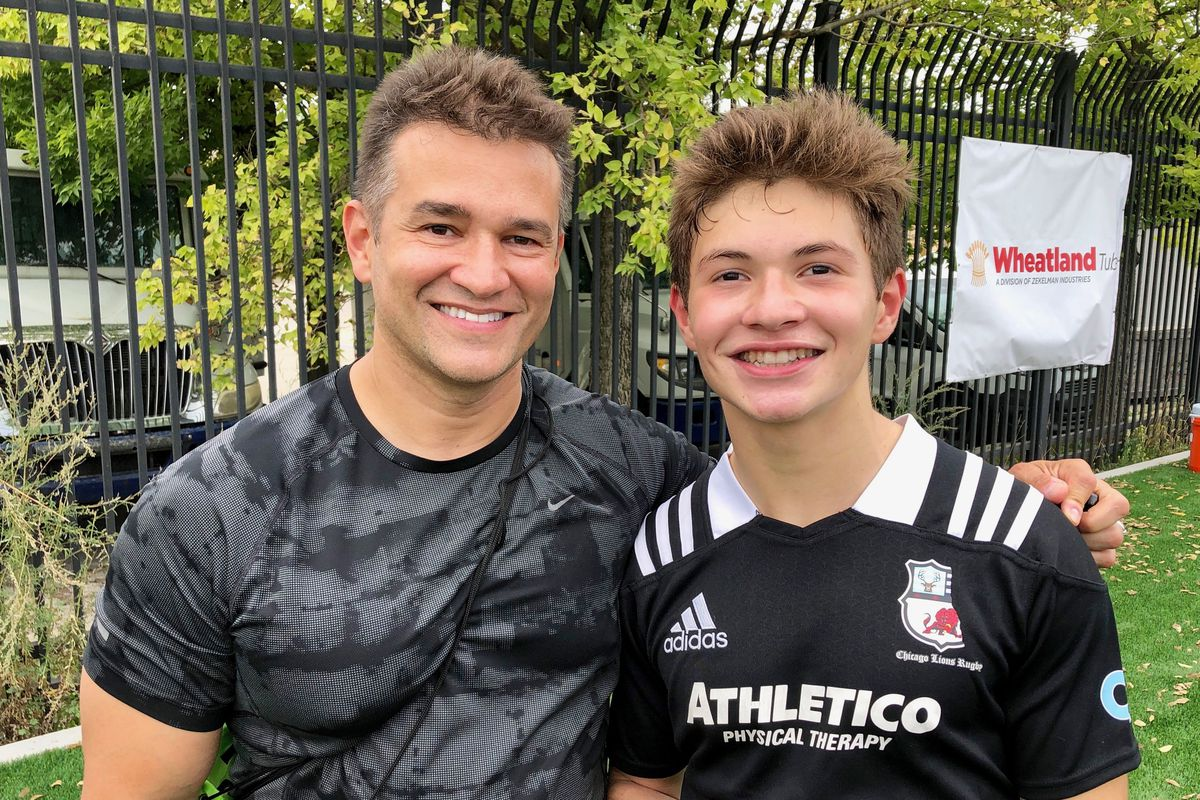 Tony Valentin and his son Anthony, at a rugby match.
