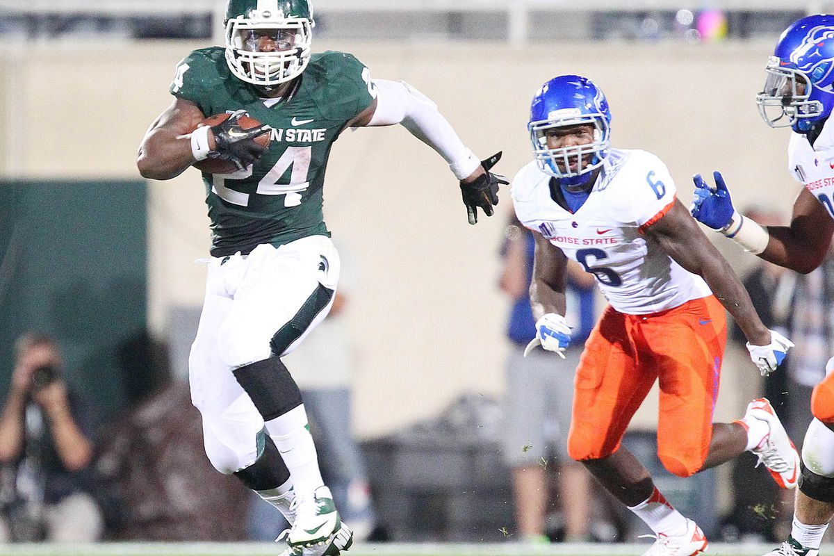August 31, 2012; East Lansing, MI, USA; Michigan State Spartans running back Le'Veon Bell (24) finds a seam in defense during the first half against the Boise State Broncos at Spartan Stadium.    Mandatory Credit: Mike Carter-US PRESSWIRE