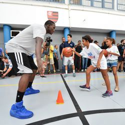 Magic guard Victor Oladipo assists with a basketball clinic in Rio for local school children.