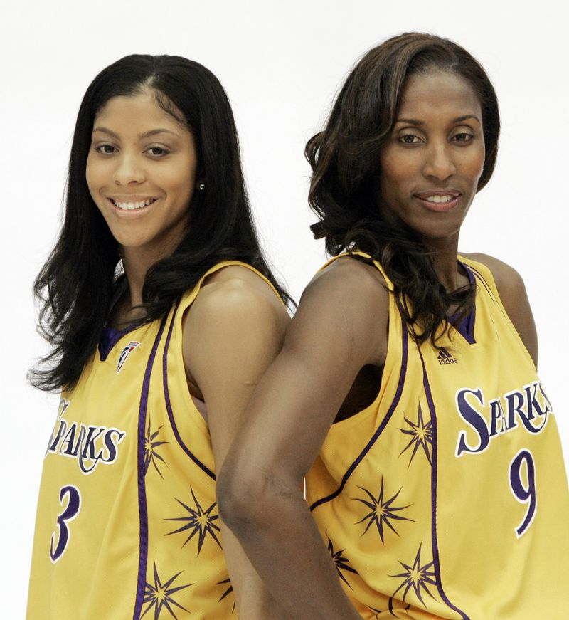 Candace Parker poses with Los Angeles Sparks teammate Lisa Leslie in 2008.