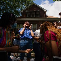 Jennifer Nava, 18, a graduate of Thomas Kelly College Prep, chants during a teach in outside Chicago Board of Education President Miguel del Valle's home in Belmont Cragin, Wednesday afternoon, June 24, 2020. The Chicago Board of Education is set to decide whether to end Chicago Public Schools' $33 million contract with the Chicago Police Department and pull out police officers from schools