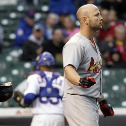 St. Louis Cardinals' Matt Holliday throws his helmet after striking out in the 11th inning of a baseball game against the Chicago Cubs in Chicago, Friday, Sept. 21,  2012. The Cubs won 5-4.
