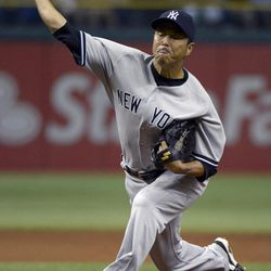 New York Yankees starting pitcher Hiroki Kuroda, of Japan, throws to home plate during the first inning of a baseball game against the Tampa Bay Rays in St. Petersburg, Fla., Saturday, April 7, 2012.