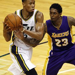 Utah Jazz guard Rodney Hood, left, looks for a teammate to pass to as Los Angeles Lakers guard Lou Williams (23) defends in an NBA regular season game at Vivint Arena in Salt Lake City, Saturday, Jan. 16, 2016.