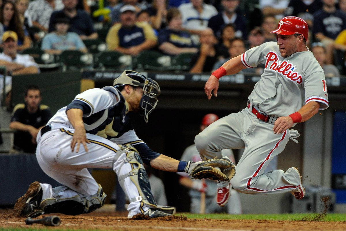 Aug 19, 2012; Milwaukee, WI, USA;   Milwaukee Brewers catcher Jonathan Lucroy (20) tags out Philadelphia Phillies right fielder Laynce Nix (19) trying to score in the eighth inning at Miller Park.  Mandatory Credit: Benny Sieu-US PRESSWIRE