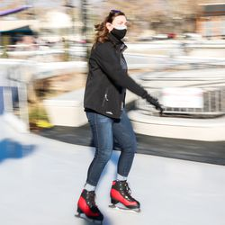 Bountiful City Councilwoman Kate Bradshaw skates at the new Bountiful Ice Ribbon during its grand opening at Bountiful Town Square in Bountiful on Saturday, Dec. 5, 2020.