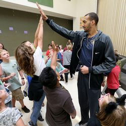 Utah Jazz center Rudy Gobert holds his hand up for high fives at Foxboro Elementary School in North Salt Lake, on Wednesday, Sept. 20, 2017.