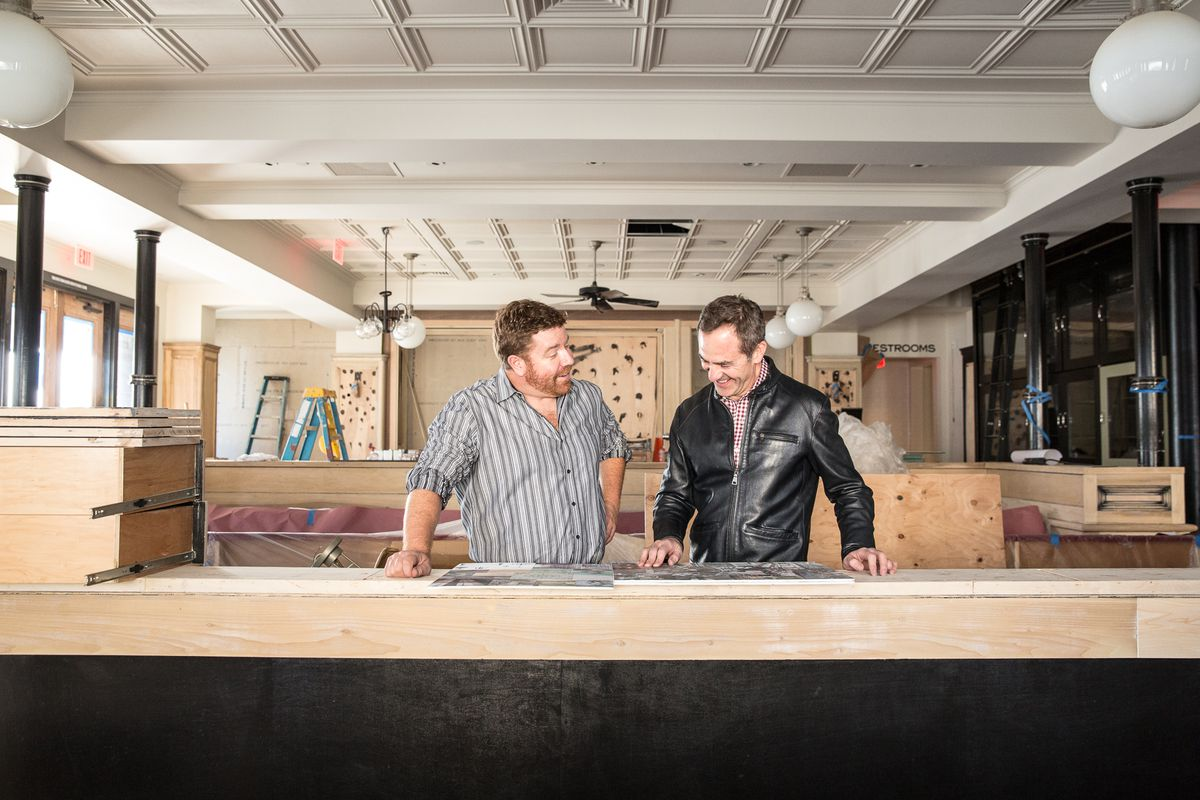 Brian Reccow and Adriano Paganini look over plans for their new Cow Hollow brasserie.