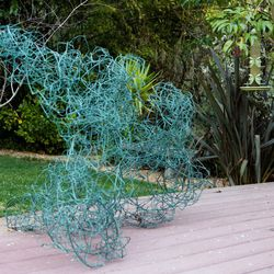 A brass sculpture on the back deck by Claire Falkenstein