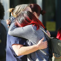 Christina Delgado hugs her daughter, Isabella, as parents arrive at Mountain View High School in Orem to pick up their children after five students were stabbed in an apparent attack by a 16-year-old boy on Tuesday, Nov. 15, 2016.