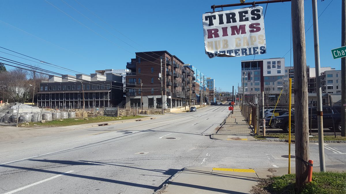 A wide-angle view shows dense development on both sides of Memorial Drive.