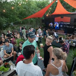 Guests attended a private concert with Bob Schneider in the backyard of the Home of the Future.