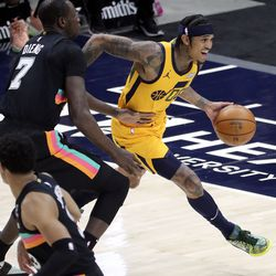 Utah Jazz guard Jordan Clarkson (00) moves around San Antonio Spurs center Gorgui Dieng (7) during an NBA game at the Vivint Smart Home Arena in Salt Lake City on Monday, May 3, 2021. The Jazz won 110-99.