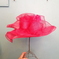 """""""Shocking pink! Frilly and fluffy. Best worn with a similar lip color."""" ($75)"""