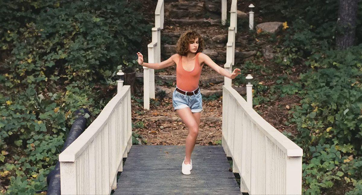Baby (Jennifer Grey) dances on a bridge