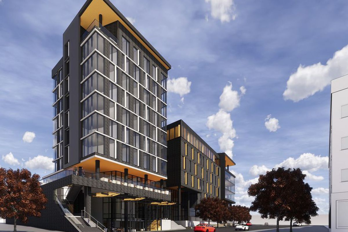 Shown in a rendering is a tall hotel with a lower rise building to the right, both in dark gray.