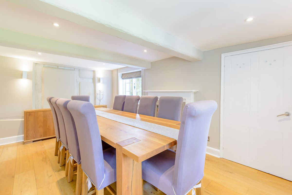 Purple chairs around table in dining room.