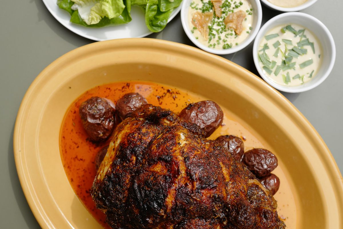 A full rotisserie chicken with potatoes, salad, and dips from Royale by Leroy, the Michelin-starred Shoreditch restaurant in east London