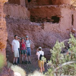 Interior Secretary Sally Jewell poses for photos as she visits ancient cliff dwellings in McCloyd Canyon near Blanding in southern Utah on Friday, July 15, 2016.