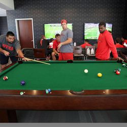 Junior Salt, left, plays pool in the new Spence and Cleone Eccles Football Center at the University of Utah in Salt Lake City on Thursday, Aug. 15, 2013.