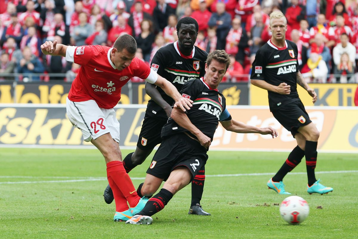 MAINZ, GERMANY: Adam Szalai of Mainz scores his team's second goal against Gibril Sankoh, Paul Verhaegh and Kevin Vogt (L-R) of Augsburg during the Bundesliga match between 1. FSV Mainz 05 and FC Augsburg.