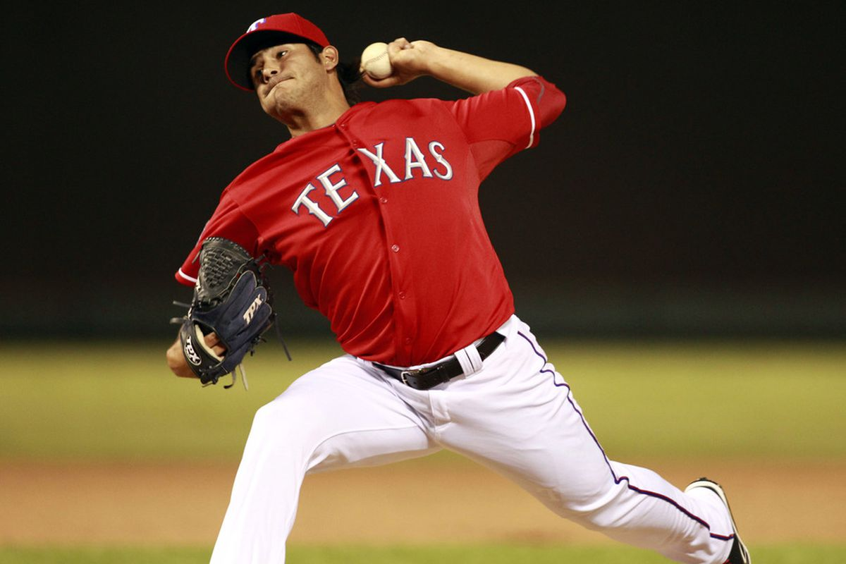 Jun 27, 2012; Arlington, TX, USA; Texas Rangers pitcher Martin Perez (33) throws a pitch during the eighth inning of the game against the Detroit Tigers at Rangers Ballpark. The Rangers beat the Tigers 13-9. Mandatory Credit: Tim Heitman-US PRESSWIRE