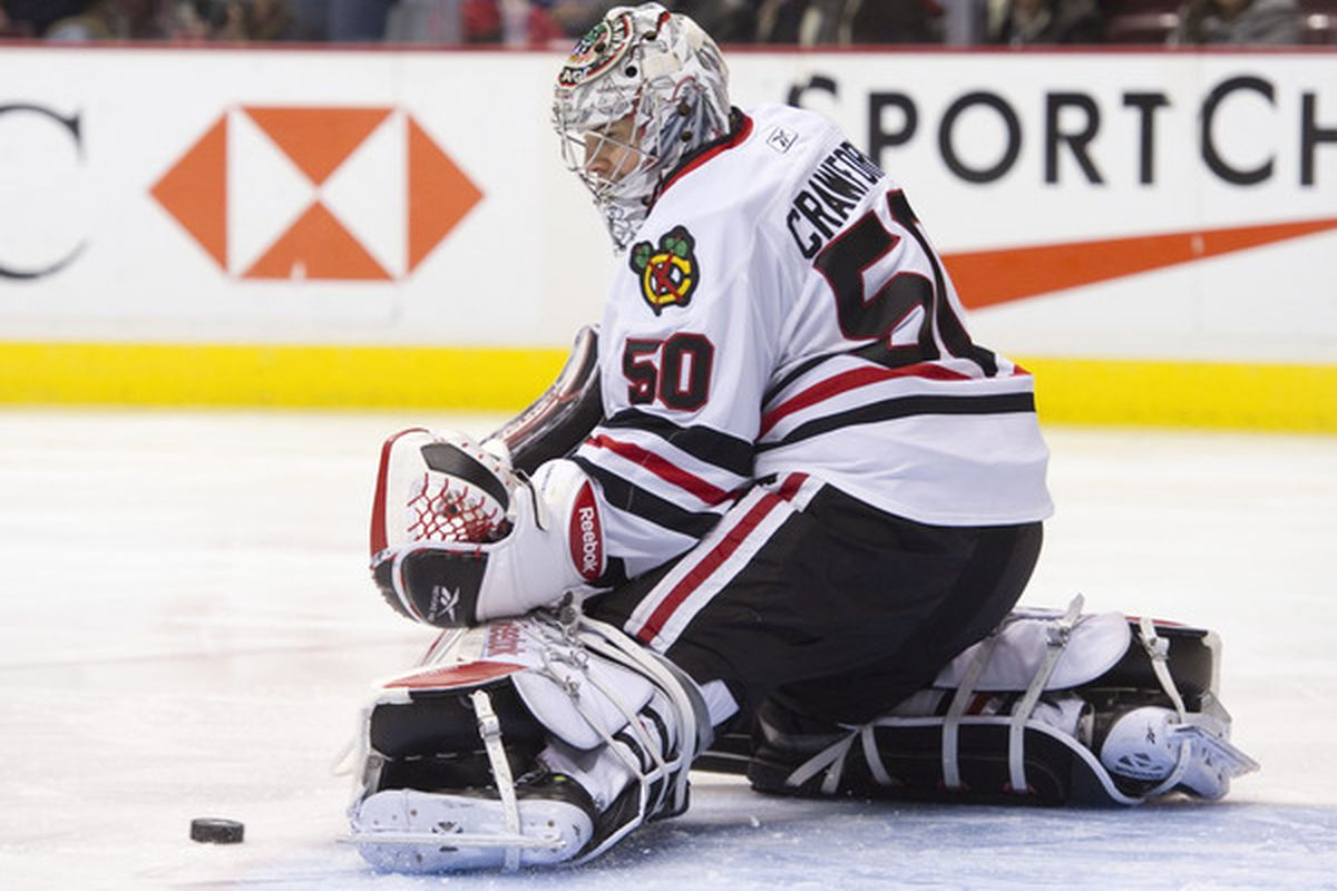 Goalie Corey Crawford of the Chicago Blackhawks makes a pad save against the Vancouver Canucks during the second period in NHL action on November 20 2010 at Rogers Arena in Vancouver British Columbia Canada.  (Photo by Rich Lam/Getty Images)