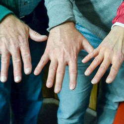 Matt Heninger's hands, center, next to his biological siblings, Jim Ward Neitzel, left, and Joyce Burgener.