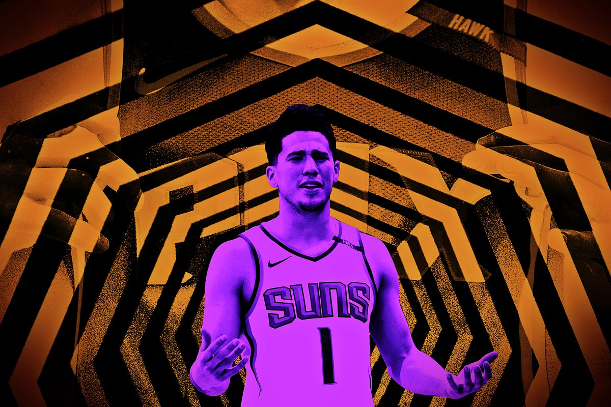 Devin Booker throwing up his hands