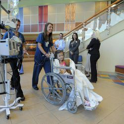 Seven-year-old Sierra Jane Downing from Pagosa Springs, Colo., is pushed in a wheel chair by a nurse following a news conference about her recovery from Bubonic Plague at the Rocky Mountain Hospital for Children at Presbyterian/St. Luke's Wednesday, Sept. 5, 2012, in Denver. It is believed Downing caught the Bubonic Plague from burying a dead squirrel.