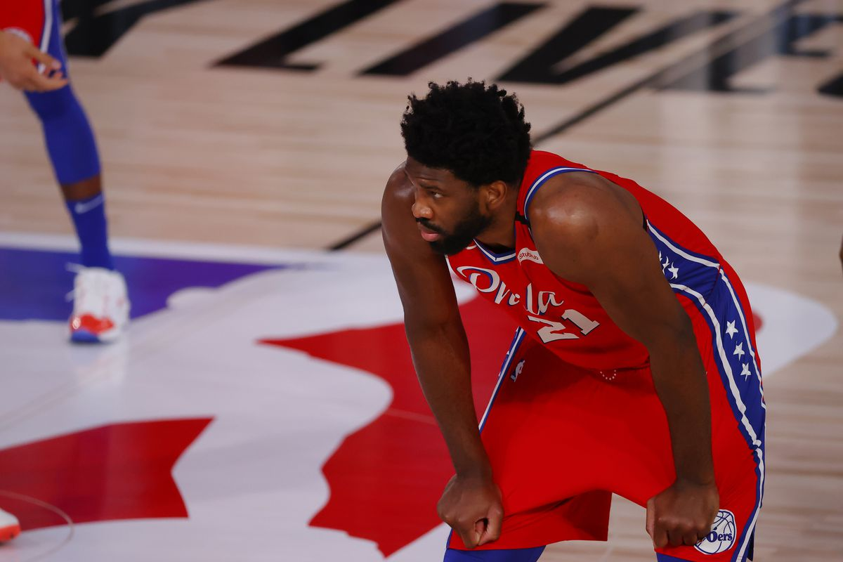 Joel Embiid of the Philadelphia 76ers looks on against the Portland Trail Blazers at Visa Athletic Center at ESPN Wide World Of Sports Complex on August 09, 2020 in Lake Buena Vista, Florida.