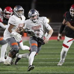 Skyridge's McCae Hillstead runs with the ball during a varsity football game against American Fork at American Fork High School in American Fork on Wednesday, Oct. 13, 2021. Skyridge won 42-22.