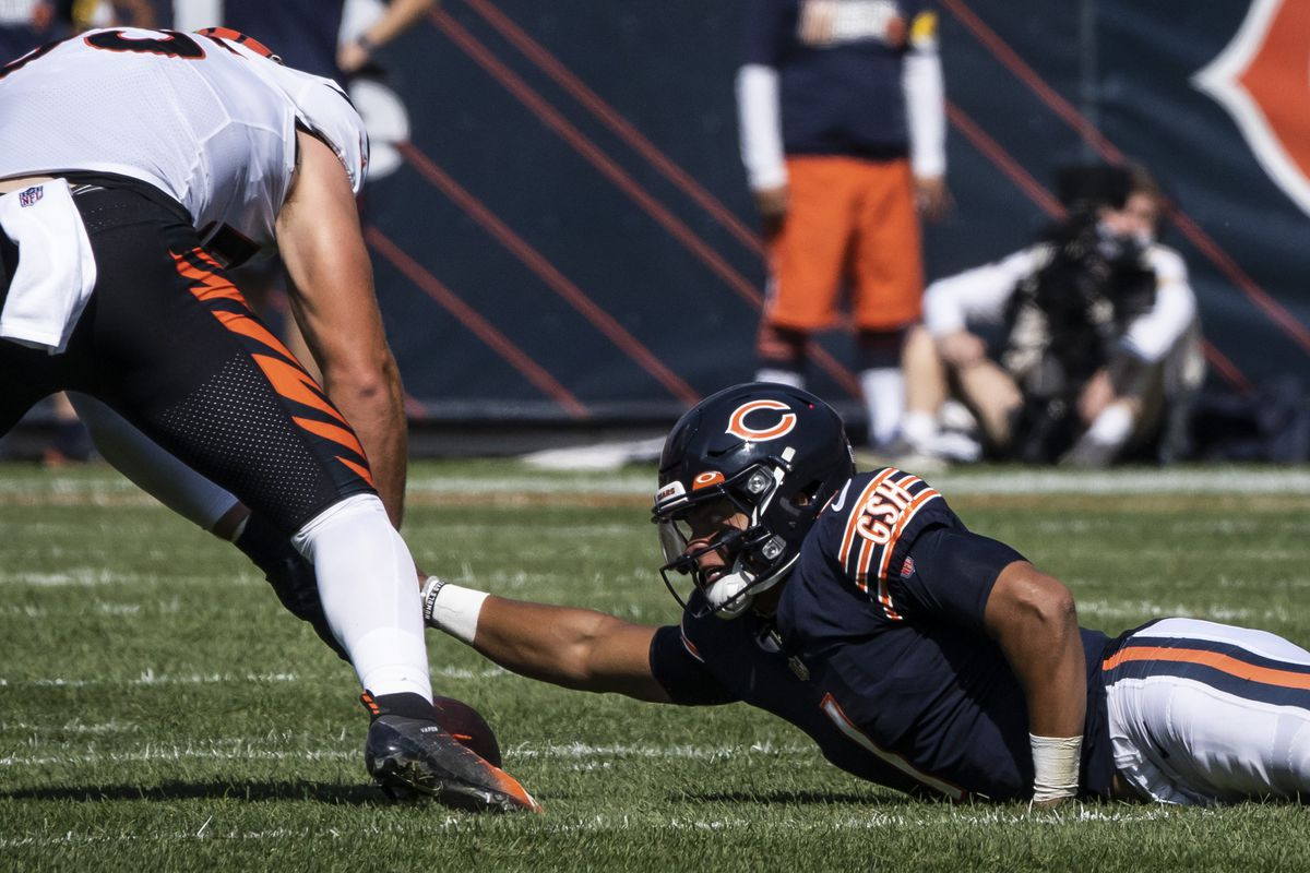 Chicago Bears quarterback Justin Fields army crawls to recover a fumble during the third quarter Sunday at Soldier Field.