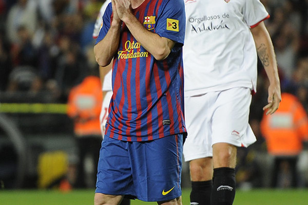 Lionel Messi of FC Barcelona reacts after missing a penalty shot during the La Liga match between FC Barcelona and Sevilla FC.