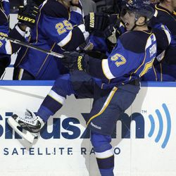 St. Louis Blues' David Perron (57) celebrates with Chris Stewart (25) after scoring during the third period in Game 5 of an NHL Stanley Cup first-round hockey playoff series against the San Jose Sharks, Saturday, April 21, 2012, in St. Louis. The Blues won 3-1 and won the series 4-1.