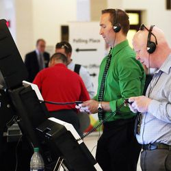 Daniel Ashman and William Black try out voting machines from Elections Systems & Software at the state Capitol in Salt Lake City on Wednesday, Aug. 2, 2017. Members of the public will be able to try out five different machines the state is considering buying.