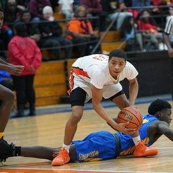 Justin Warren (11) of Young gets steal against Simeon, Wednesday 02-13-19. Worsom Robinson/For the Sun-Times.