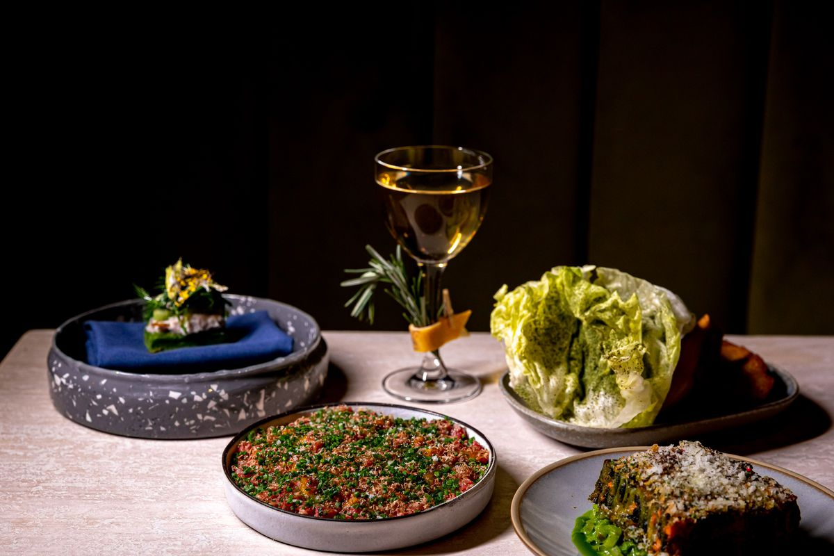 From left to right: Smoked whitefish financier; beef tartare served with iceberg lettuce and sourdough crostini; kale bolognese pasta; Flashing Lights