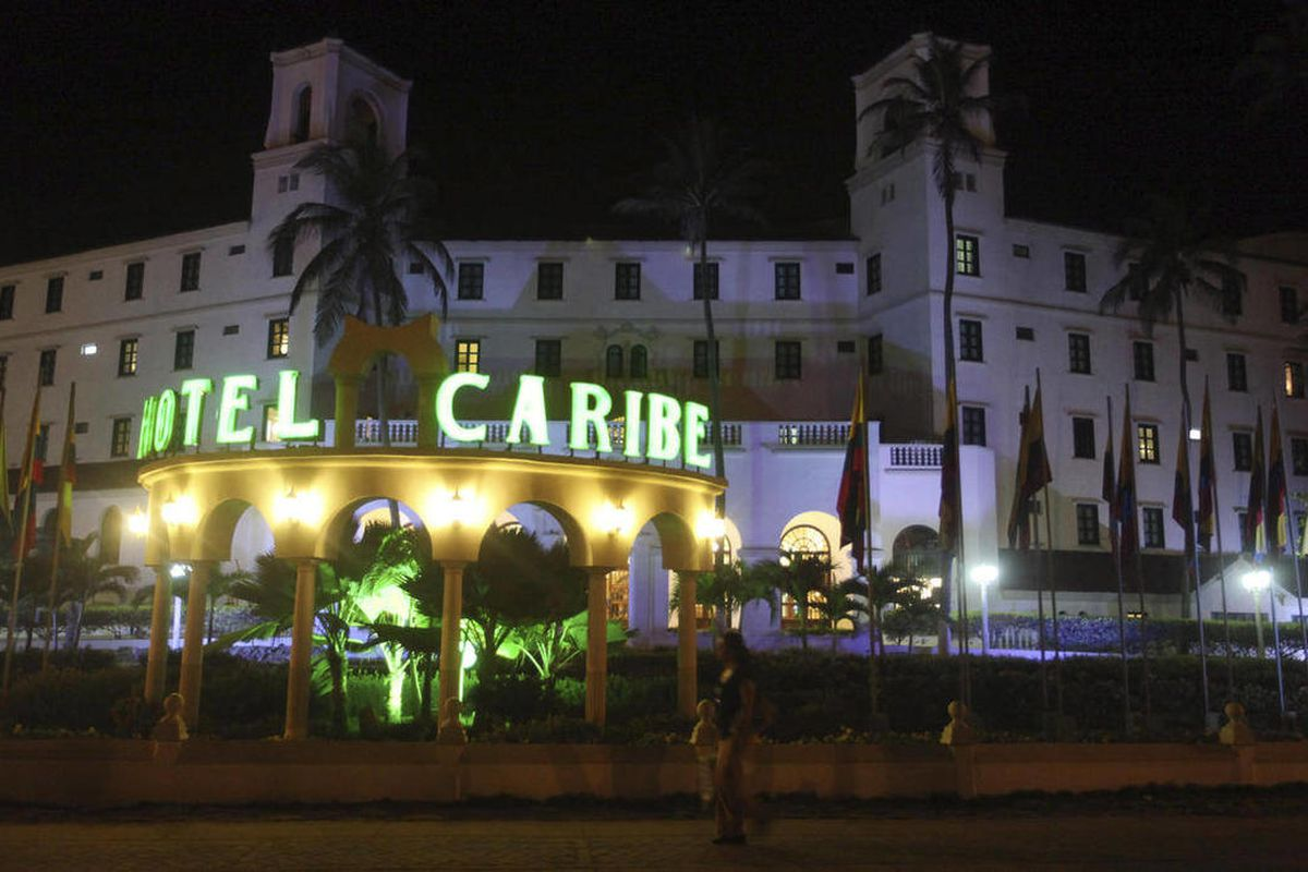 FILE - In this April 19, 2012, file photo, people walk past Hotel El Caribe in Cartagena, Colombia. Washington politicians are doing a delicate dance around the Secret Service prostitution scandal. People are loath to criticize agents trained to take a bu