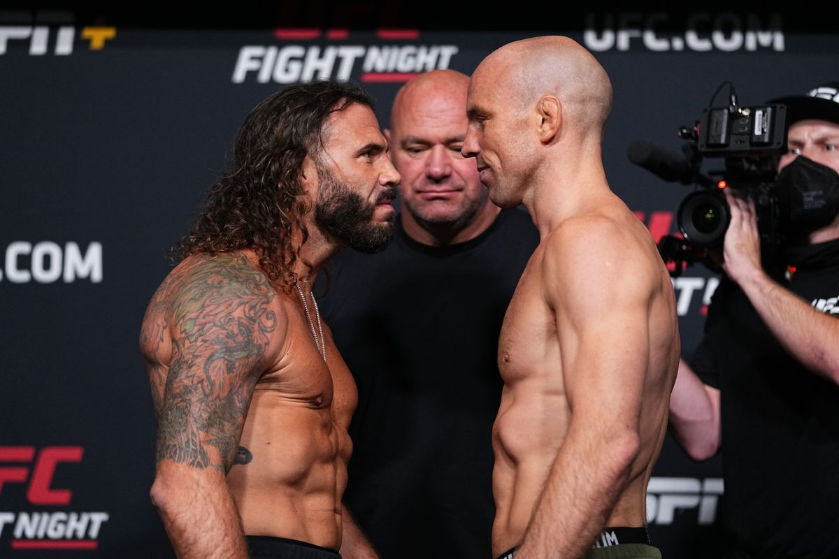 In this UFC handout, opponents Clay Guida and Mark Madsen of Denmark face off during the UFC Fight Night weigh-in at UFC APEX on August 20, 2021 in Las Vegas, Nevada.