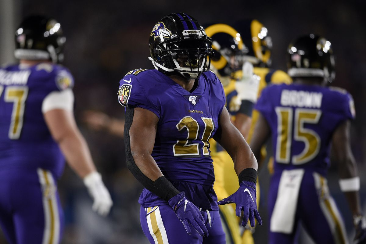 Baltimore Ravens running back Mark Ingram II  reacts after a run during the first half against the Los Angeles Rams at Los Angeles Memorial Coliseum.