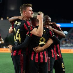 FOXBOROUGH, MA - APRIL 13: Atlanta United FC midfielder Julian Gressel #24 celebrates with his teammates after Ezequiel Barco's first half goal against the New England Revolution at Gillette Stadium on April 13, 2019 in Foxborough, Massachusetts. (Photo by J. Alexander Dolan - The Bent Musket)