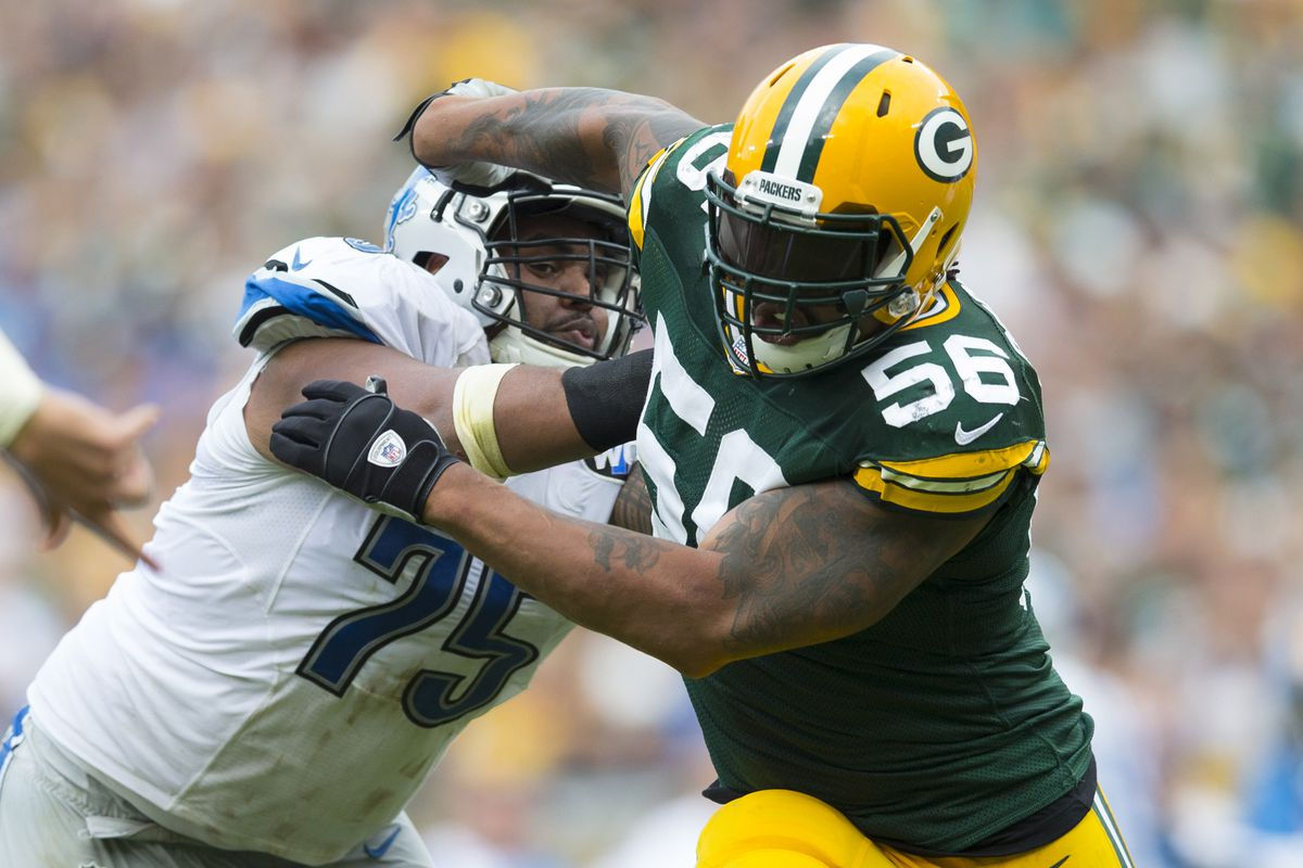 GREEN BAY, WI - Detroit Lions guard Larry Warford (75) clears Green Bay Packers linebacker Julius Peppers (56) out of the way during the fourth quarter at Lambeau Field.