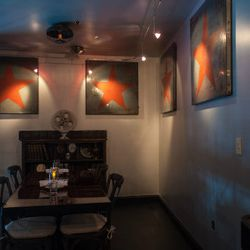 Private dining area; wall art is from a Russian factory.
