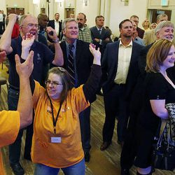 Supporters of Mia Love, 4th Congressional District Republican candidate, celebrate while she is ahead on election night in Salt Lake City, Tuesday, Nov. 4, 2014. At left are Joseph Hancock and Joleen Poe.