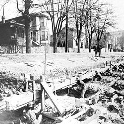 Gas and electrical pipes are installed along South Temple in the 1900s. The streets were torn up again and again during this time period.
