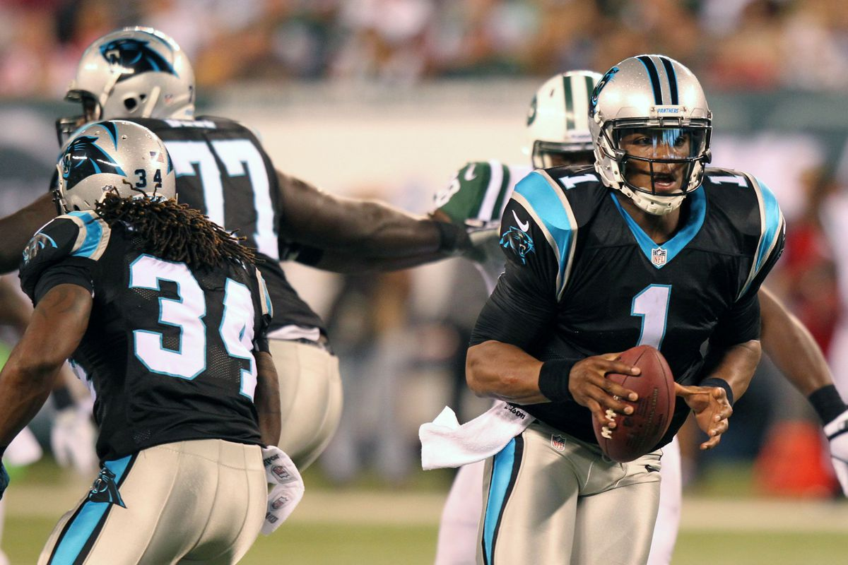 Aug 26, 2012; East Rutherford, NJ, Carolina Panthers quarterback Cam Newton (1) turns back to carry during the first quarter against the New York Jets at Met Life Stadium. Mandatory Credit: Anthony Gruppuso-US PRESSWIRE