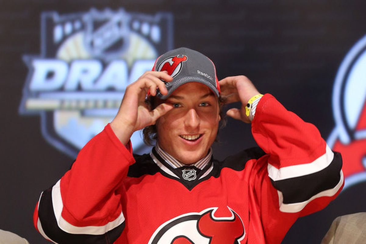 Stefan Matteau puts on a cap after being drafted by the New Jersey Devils at the 2012 NHL Entry Draft.